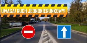 Informacja o ruchu jednokierunkowym, w tle jezdnia drogowa